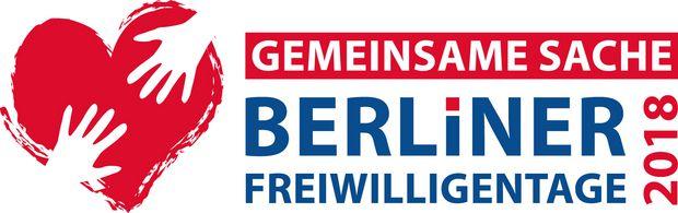 Logo Berliner Freiwilligentage Schriftaufzug rot blau Herz mi umfassenden Händen